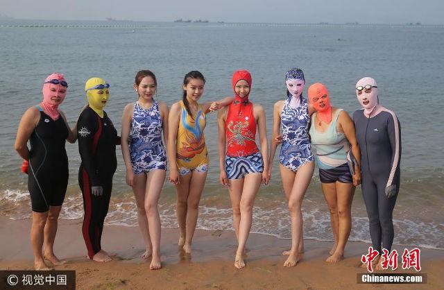 Đến hẹn lại lên, các bãi biển Trung Quốc nở rộ áo tắm Ninja đi nghỉ mát của 500 chị em sợ cháy nắng - Ảnh 9.