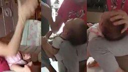 Kinh hãi người giúp việc ấn đầu, tát bôm bốp vào mặt em bé 3 tháng tuổi
