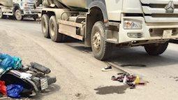 Nam sinh vừa đi thi về đã gặp tai nạn, áo sơ mi cùng chai nước uống dở nằm trước mũi xe bồn