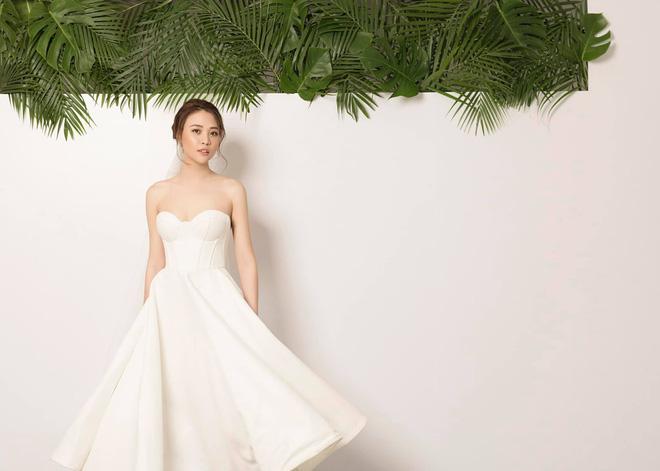 Không hổ danh Hoa khôi, Đàm Thu Trang tung ảnh cưới đơn giản nhưng vẫn xinh đẹp yêu kiều hết phần thiên hạ - Ảnh 1.