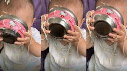 Làm đổ đồ ăn vương vãi nhưng vẫn cắm cúi ăn, cô bé còn gây bất ngờ hơn khi để lộ gương mặt sau chiếc bát