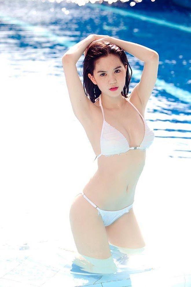 Ảnh ít biết sau những bức hình bikini nóng bỏng của Ngọc Trinh - Ảnh 1.