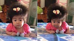 Cô nhóc 3 tháng tuổi có mái tóc dày và xù bông như trẻ 2 - 3 tuổi khiến nhiều người ngỡ ngàng