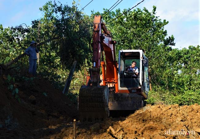 Ảnh: Nỗ lực mở đường tiếp cận cứu hộ nạn nhân vụ sạt lở núi ở xã Trà Leng - Ảnh 10.