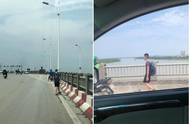 Phạt con đi bộ trên cầu Vĩnh Tuy dưới trời nắng, người mẹ bị dân mạng chê trách ngược đãi - Ảnh 1.