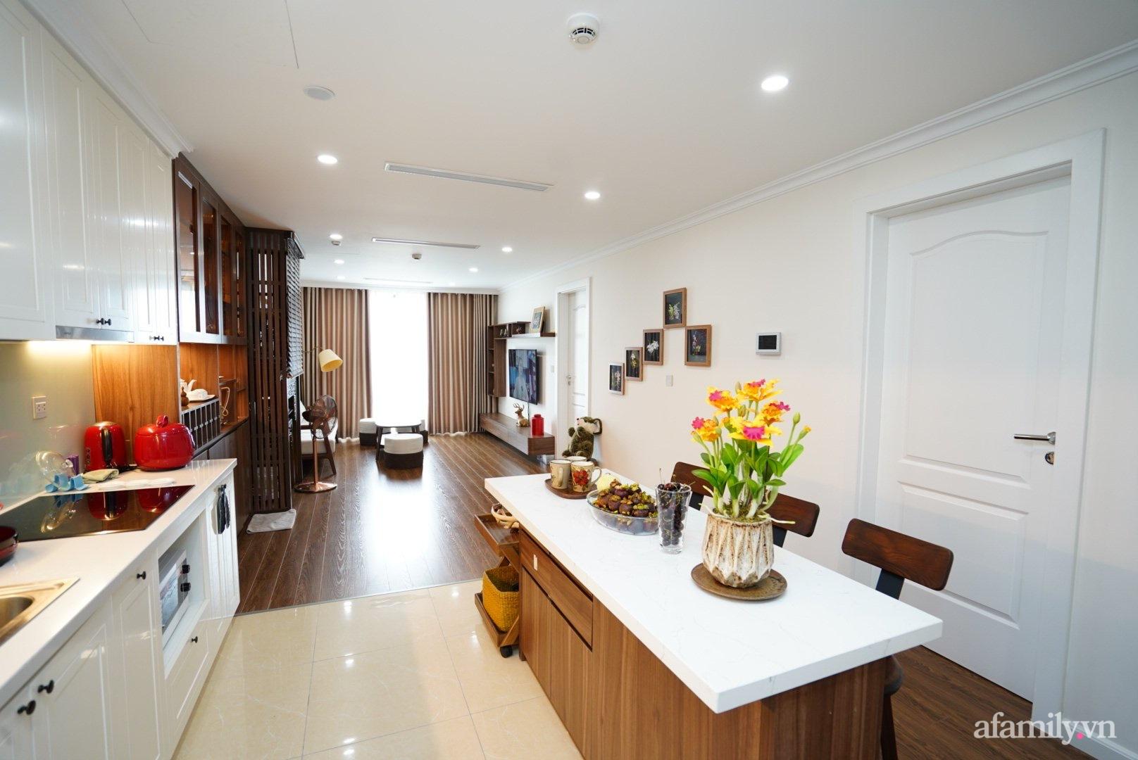 Căn hộ 107m2 đẹp sang trọng với nội thất màu gỗ óc chó có chi phí hoàn thiện 150 triệu đồng ở Hà Nội - Ảnh 5.
