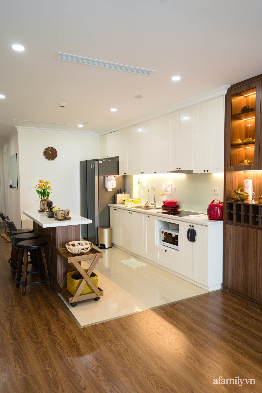 Căn hộ 107m2 đẹp sang trọng với nội thất màu gỗ óc chó có chi phí hoàn thiện 150 triệu đồng ở Hà Nội - Ảnh 8.