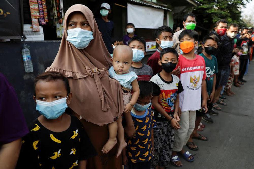 Tín hiệu đáng sợ từ Indonesia: Trẻ em không còn an toàn với Covid-19, hàng trăm ca đã tử vong - Ảnh 1.